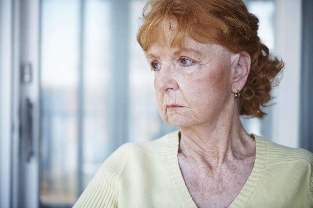 A cropped shot of an unhappy senior woman sitting thoughtfully on her porch at home